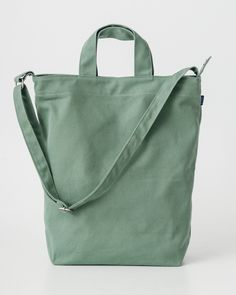 Baggu - Duck Bag - Olive. A perfect everyday tote in durable recycled cotton canvas duck. Two handles and 40 in. adjustable strap, to carry in hand or over shoulder.