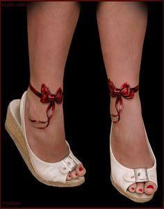 Her BRIGHT red, satiny ribbon tied into a CUTE little bow around her ankle looks ADORABLE with her fire engine-red toenails peeking out of her white peep-toe wedge sandal. SWEET!