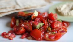 Tomato, pomegranate and roasted pepper salad