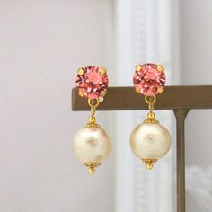 MiyabiGrace: Peach Swarovski Crystals and Light Beige Cotton Pearl Invisible Clip on Earrings コットンパールイヤリング #cottonpearls #cottonpearlcliponearrings #cottonpearlearrings #pearlcliponearrings #LightBeigepearlcliponearrings #pearlearrings #ClipOnEarrings #danglepearlcliponearrings #invsiblecliponearrings #nonpiercedearrings #pearlnonpiercedearrings #コットンパール #コットンパールイヤリング #コットンパールノンホールピアス #コットンパールピアス#スワロフスキーイヤリング #Earrings #Jewelry #SwarovskiClipOnEarrings #PinkSwarovskiClipOnearrings