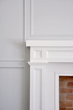 Fireplace mantle details, inset trim, paneled walls, hex tile hearth