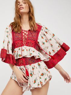 Kissed By The Sun Set | Mixed print set featuring a floral print allover with boho-inspired embroidered details throughout.    * Top features a cute cropped fit with wide sleeves, a front lace-up design and a back keyhole cutout   * Shorts feature a wide waistband with a stretchy smocked back detail and a flowy shape at the leg