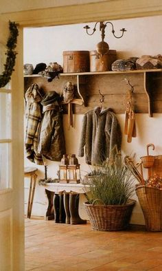 Nicely decorated mud room or entrance hall, incorporating winter apparel and decor. Great idea.