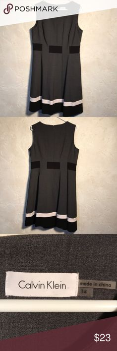 Calvin Klein Dress Calvin Klein size 14 sleeveless dress. Charcoal gray, black and white. There are small holes that run through the black middle for a small belt to run through. This can be seen in the 5th photo. Does not come with a belt. Back zipper with hook and eye. Lined.         01/6.3 Calvin Klein Dresses