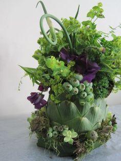 arrangement in artichoke with kale, curly garlic, sweetpeas and texture, Françoise Weeks