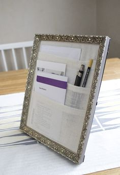 DIY Table organizer using some old fabric, a frame, glue, and some stitching (but you could totally get away with those hemming strips for this)