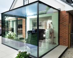 A glass box extension was installed to this new build home including minimal windows® sliding doors. The structural glass roof and structural glass walls allow light to flood into the home. Glass Roof Extension, Porch Extension, House Extension Design, Extension Office, Garden Room Extensions, House Extensions, Residential Architecture, Architecture Design, Glass Porch