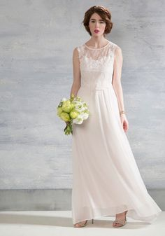 Commanding all 'aisles' on you with delicate detailing, this ivory gown is the embodiment of bliss. Crocheted lace cap sleeves sit atop the elegant bodice appliques and elasticized back cutout of this ethereal dress, giving its floor-length silhouette a twist of retro allure that's all your own.