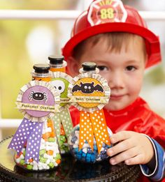 Apothecary Treat Holders     Design by Lisa Storms  Fill apothecary jars with Halloween-color candies. Wrap the top of each jar with a strip of orange cardstock for added decoration. Label each jar with a best costume ribbon, so kids can claim their awards.