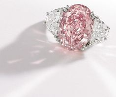 The price results for the fancy colored diamond jewelry seen in Sotheby's Magnificent Jewels Auction continue to demonstrate the investment potential that colored diamonds hold Pink Diamond Wedding Rings, Pink Diamond Engagement Ring, Pink Diamond Ring, Solitaire Engagement, Pink Jewelry, Diamond Jewelry, Big Engagement Rings, Colored Diamonds, Pink Diamonds