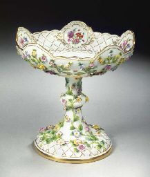A Meissen porcelain flower-encrusted pedestal coupe.  this is a very pretty but unusual looking pattern...