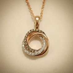Rose gold, white diamonds and chocolate diamonds are twisted together in this elegant pendant #SmokinJoesJewelry #rosegold #chocolatediamonds #diamond