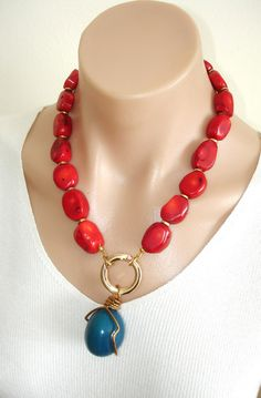 CLICK HERE TO BUY:  www.etsy.com/...    ASHIRA Natural Red Coral Necklace with Turquoise Blue Tagua Ivory Nut Pendant Wire Wrapped in Brass. $235.00, via Etsy.
