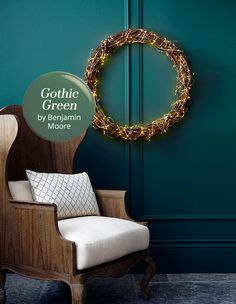 Gothic green by Benjamin Moore is a muted evergreen with a slight teal undertone. This paint color works perfectly in a library or country house.