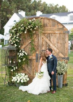 Standalone wooden doors mark the entrance to this couple's next chapter of their lives together. Click to view 10 Stunning Wedding Backdrops: http://www.colincowieweddings.com/articles/ceremony-reception/10-stunning-wedding-backdrops