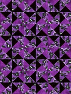 Cotton fabrics are fun, whimsical black bats with large white eyes flying about on a mottled purple background fabric. Purple spider webs on a purple background. And golden yellow dots on a back backg