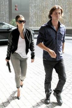 Looking cool and collected, Kim Kardashian was spotted arriving at Miami's Four Seasons Hotel with her best friend Jonathan Cheban this afternoon (November Jonathan Cheban, Four Seasons Hotel, White T, Green Pants, Kardashian Style, Black Heels, Casual Looks, Bomber Jacket, Leather Jacket