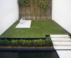 Modern Zen patio at Renovated Townhouse in Jane Street in NYC by Steven harris Architects LLP