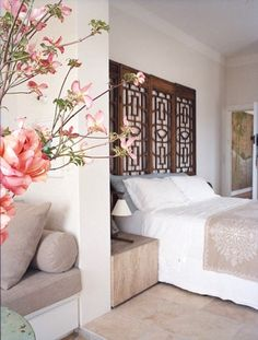 use a room divider as a headboard.  This is what I want to do.