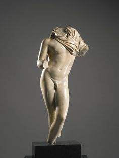 A MARBLE TORSO OF NARCISSUS OR GANYMEDE, ROMAN IMPERIAL, CIRCA 1ST CENTURY A.D.