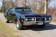 My ideal car - 1968 Hurst Olds 442. Isn't she beautiful? (http://www.carpictures.com/Oldsmobile/442-black-1968-03LSB251243877#)
