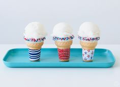 Celebrate the all-American holidays of summer with DIY patriotic ice cream cones. Includes free, downloadable, red, white, and blue ice cream cone wrappers.