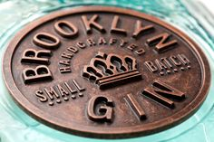 """""""Blending old-world craftsmanship with today's artistic, vibrant culture. The bottle structure pays homage to the apothecary origins of gin, reinforcing its place in the new speakeasy, while the medallion label – stamped in metal – celebrates the authentic spirit at the core of the brand. For the modern mixologist, Brooklyn Gin captures the magic and magnetism of a time and a place where the cocktail is king."""""""