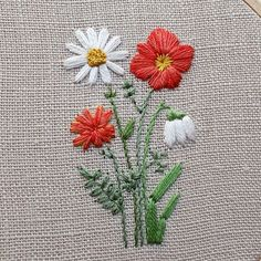 Crewel Embroidery Here's a closer look at a hoop that went out last month. From left to right: marigold, daisy, poppy, and snowdrop. ❤ Have a great weekend! Brazilian Embroidery Stitches, Crewel Embroidery Kits, Hand Embroidery Flowers, Flower Embroidery Designs, Simple Embroidery, Embroidery Patterns Free, Ribbon Embroidery, Cross Stitch Embroidery, Embroidery Techniques