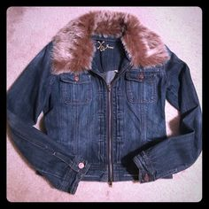 Jean jacket with fur Wore once fits small on me. Fur can be taken off to wash. XOXO Jackets & Coats Jean Jackets