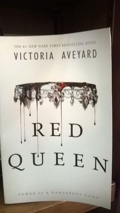 Red Queen by Victoria Aveyard. 9781409155843. This book drew me in for the use of space. Book covers are often filled with images, but this book only has a crown and blood. The blood signifies an ancient barrier which is tested. The main character plays a deadly game with the royal family, which is where the crown gives clue to. I would recommend this book because it has qualities that almost any reader would enjoy: adventure, suspense, romance, and danger.