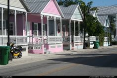 The precious little wooden 'shot-gun' cottages on Truman Avenue in the 'Heart of Old Town' Key West neighborhood, were originally build for cigar makers over 100 years ago.