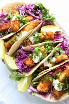 Fish Stick Tacos  Transform Taco Tuesday with crispy cod and crunchy slaw.  Get the recipe from Delish.