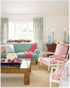 Teal couch & love the fabric on the chairs