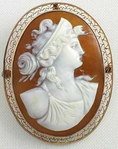 Gold mounted filigree Victorian sardonyx shell antique cameo brooch - classic Roman beauty.  I love the Brown shell.