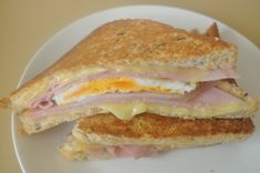 I love this sandwich that is a signature dish at Denneys, Moon Over My Hammy. Like most things, it is much more economical to make at home and even, dare I say, better! I originally grilled this in butter, but after reading Dawnabs recipe for Grilled Cheese Diner Style, I will only grill sandwiches in mayo.  You can use whichever you like best.  This is great for a Sunday morning breakfast with fresh fruit.