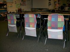 Cheap stretchy book covers used as chair pockets in classroom to hold journals or whiteboards & markers... cool.  These are super inexpensive at back-to-school time.