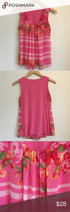 New York & Co Pink Floral Striped Tank Small This charming tank top is from New York & Company. It has a beautiful pink print with flowers and stripes. The overlay is made of lightweight material, and rests on top of a very stretchy lining. This top is perfect for spring and summer! It would be great to wear to work, to parties, or just everyday wear.  Size Small. Used in great condition! There is a very small mark and some pilling on the side (pictured). New York & Company Tops