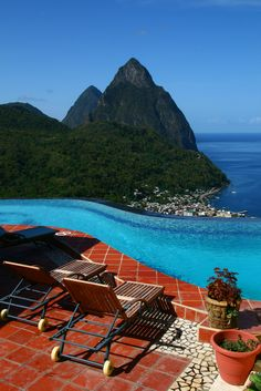 Infinity pool with one of the worlds most gorgeous views - St Lucias Pitons from La Haut Plantation