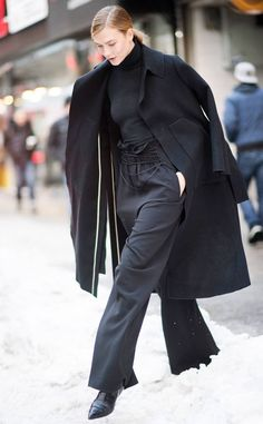 Karlie Kloss from Best Celeb Street Style From NYFW Fall 2017  This all-black outfit is far from boring. Check out the detailing around the model's waist!