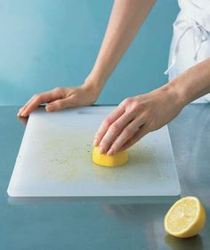 A lemon works to remove tough food stains from a plastic or light-colored wood cutting board. Squeeze on the juice of one half, rub it in, and let sit for 20 minutes before rinsing. | Some of our smartest ways to rethink common items.