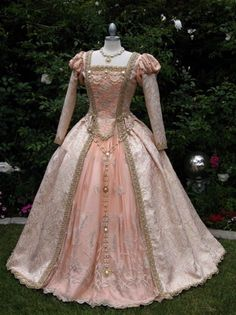 Dress from the 1800's in peach. Although I'm not much for the color the style is so beautiful! If on;y we still dressed like this.