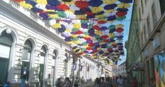 Party-colored umbrellas take Timisoara's uptown by storm - The Romania Journal Colorful Umbrellas, Colorful Party, Romania