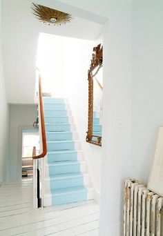 Robin's egg blue stair runner...I may have to do this in my house one day... :)