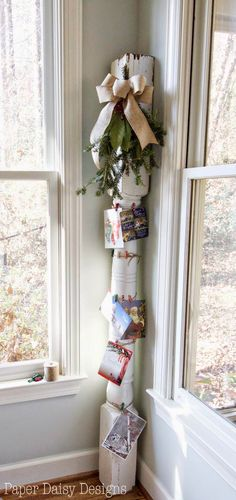 Display your Christmas cards on an old house column tied up with string. Full Christmas home tour with other budget ideas for holiday decorating.