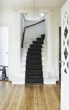 I want my stairs to look like this! Love the charcoal grey runner and white painted steps