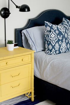 Craigslist dresser spray painted with Valspar's Flat Caramel Honey—a deep, golden yellow. Great spray paint tutorial from  Emily A. Clark