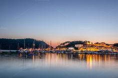 Check out Night at the harbour by ChristianThür Photography on Creative Market