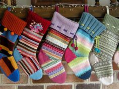 Betz White recycled a rainbow of candy-colored sweaters into adorable stockings and trimmed them with ribbons and other notions.
