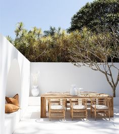 A Modern Outdoor Getaway Patio Design With Natural Rattan Chairs And Light Wood Dining Table For The Perfect Outdoor Entertaining And Dining Area. Featuring A Build In Arched Daybed Bench With Natural Tan Throw Pillows Design Exterior, Interior And Exterior, Outdoor Spaces, Outdoor Living, Outdoor Decor, Outdoor Kitchens, Garden Design, House Design, Patio Design