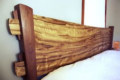 Matt Downer Designs Natural Edge Headboard - wood slabs available at http://www.BerkshireProducts.com